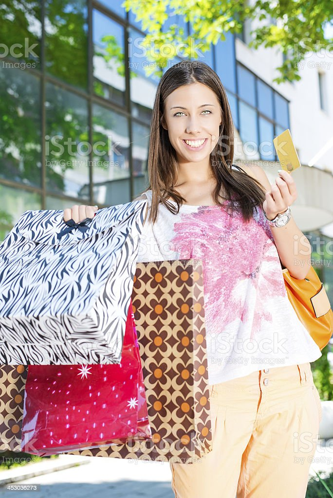 Young lady holding Gold Card while shopping royalty-free stock photo