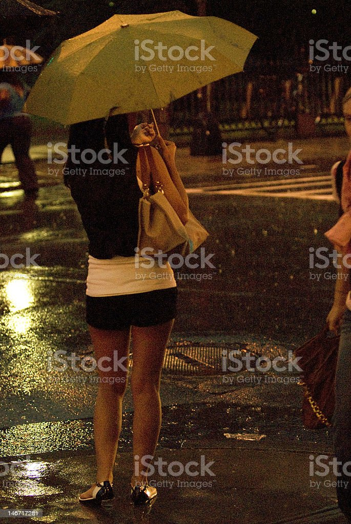 Young Lady holding yellow umbrella royalty-free stock photo