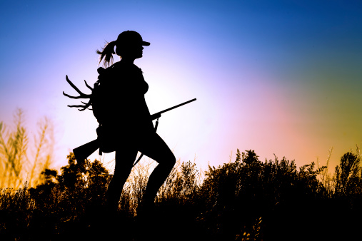 young Lady on a Deer Hunt at sun sunset