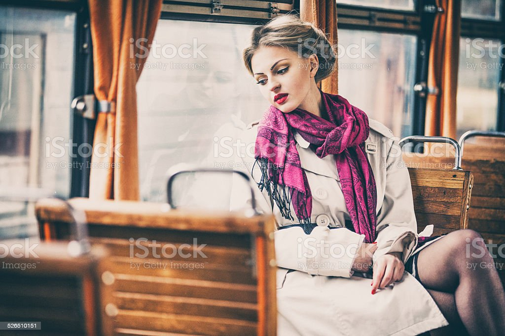 Young lady in a vintage train wagon stock photo