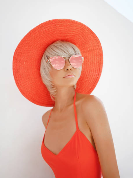 Young lady in red hat and sunglasses stock photo