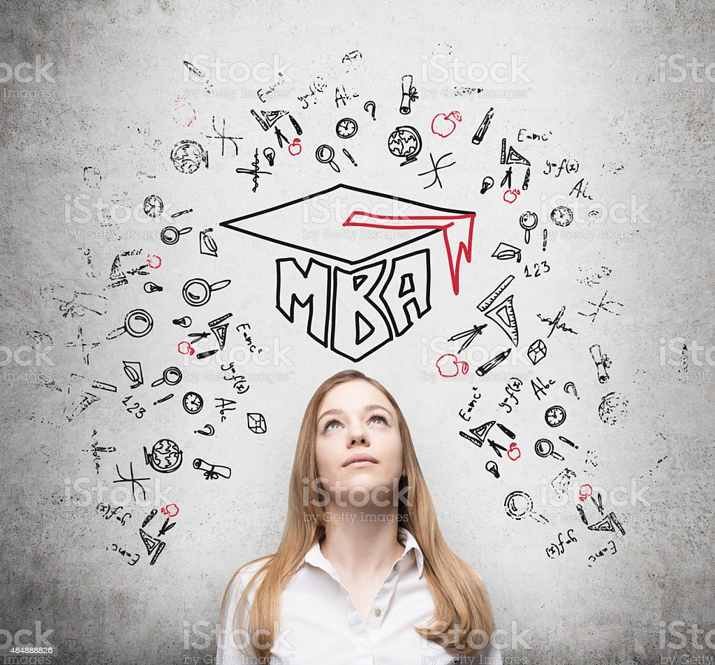 Young lady is thinking about MBA degree. stock photo