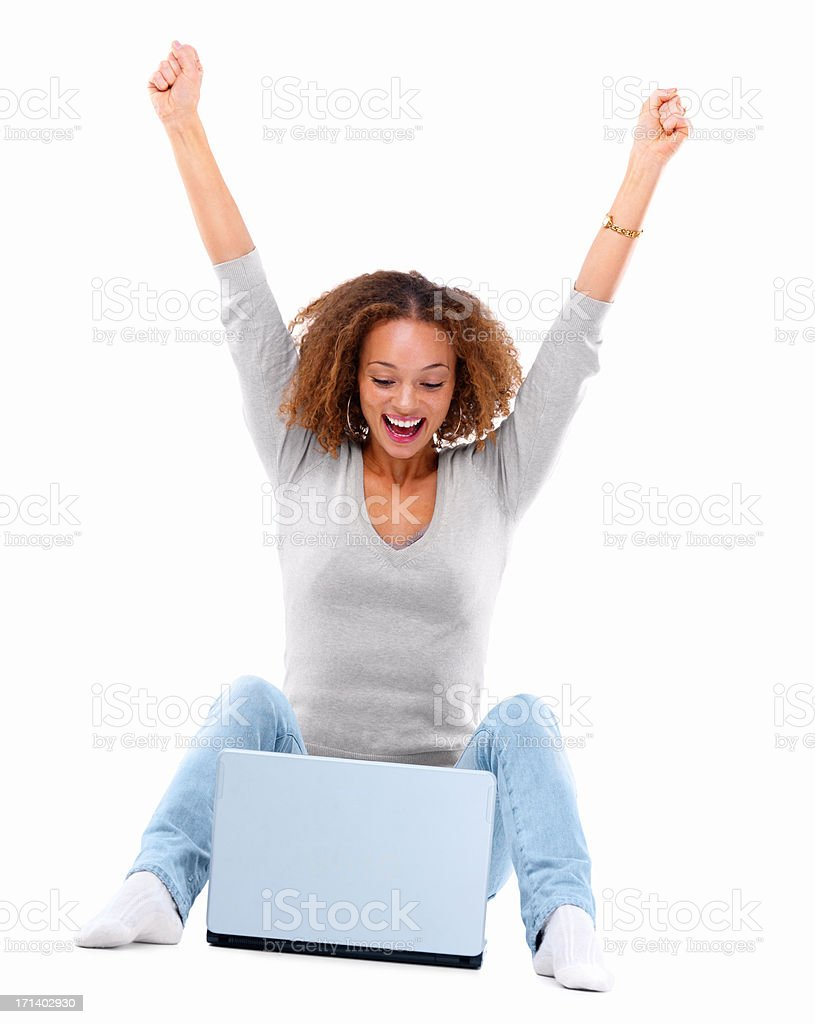 Young lady laughing in front of a laptop isolated on white background stock photo