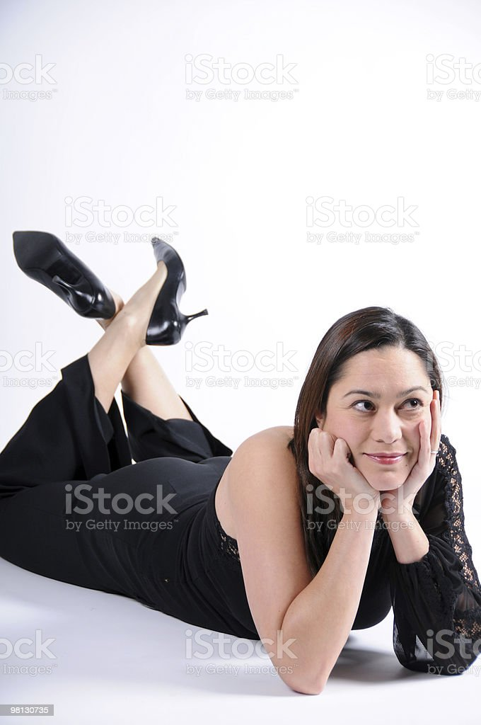 Young lady laying on floor looking up royalty-free stock photo