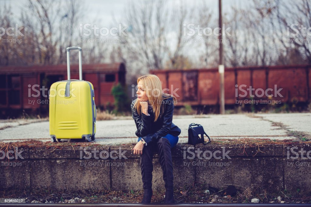 Young lady miss the train stock photo