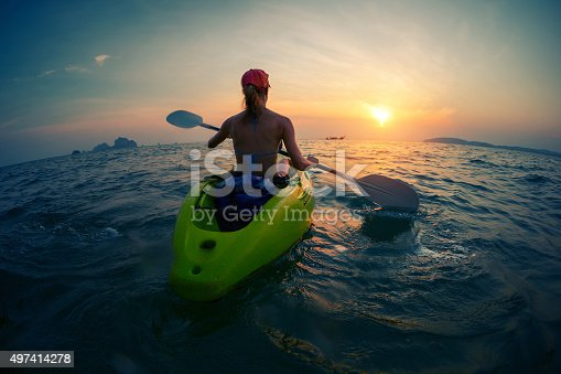 istock Young lady paddling the kayak 497414278
