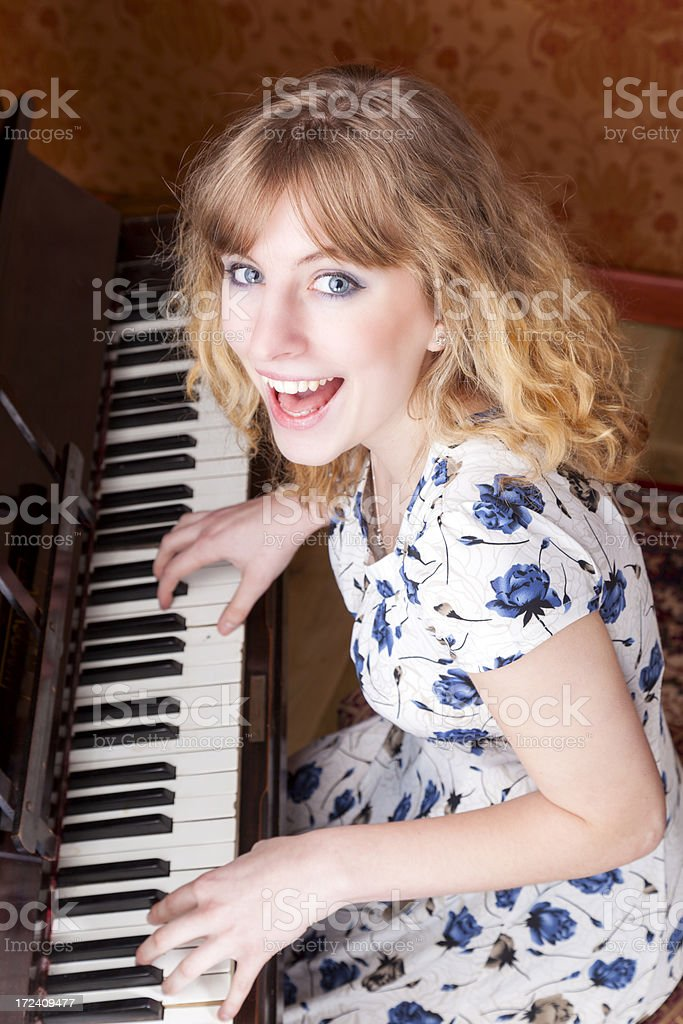 Young Lady Playing The Piano royalty-free stock photo