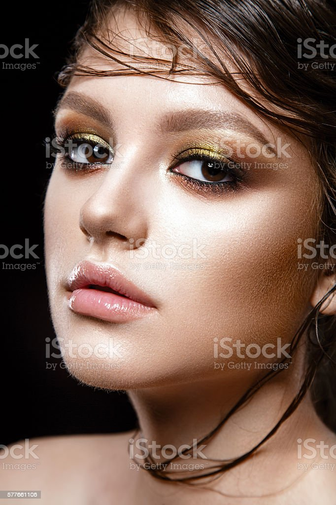 Young lady posing close up on black background. stock photo