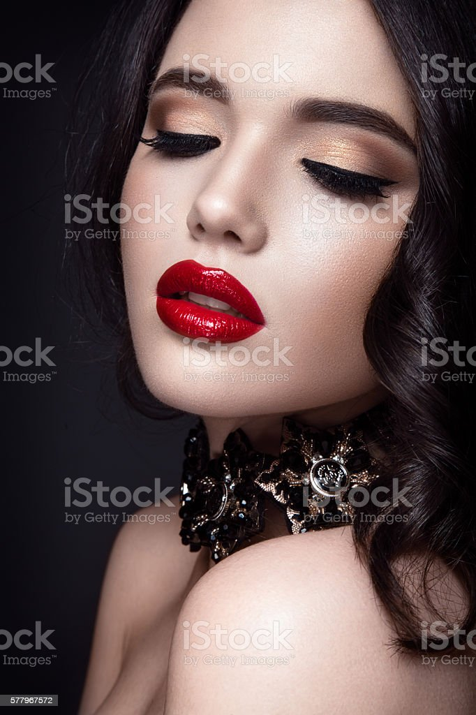 Young lady posing close up on black background stock photo