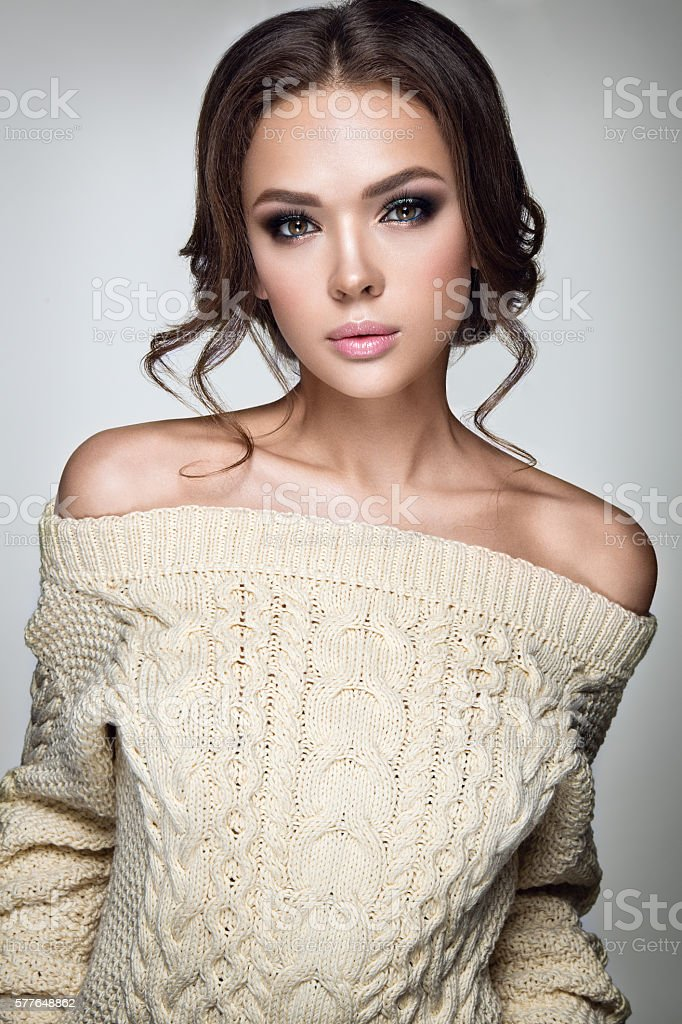 Young lady posing in warm sweater stock photo