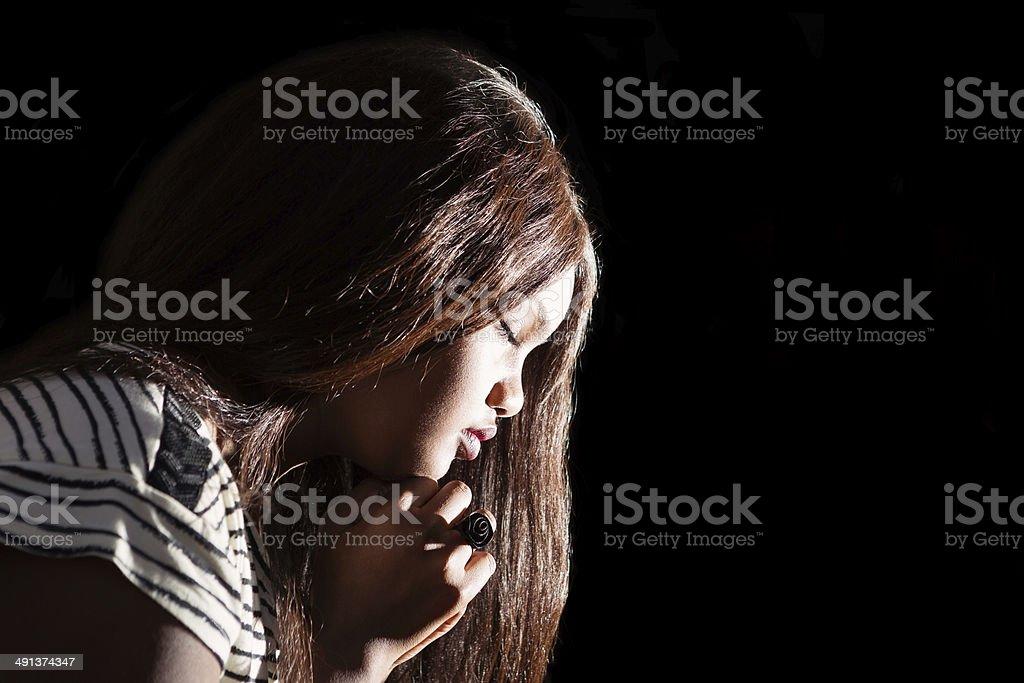 Young Lady Praying stock photo