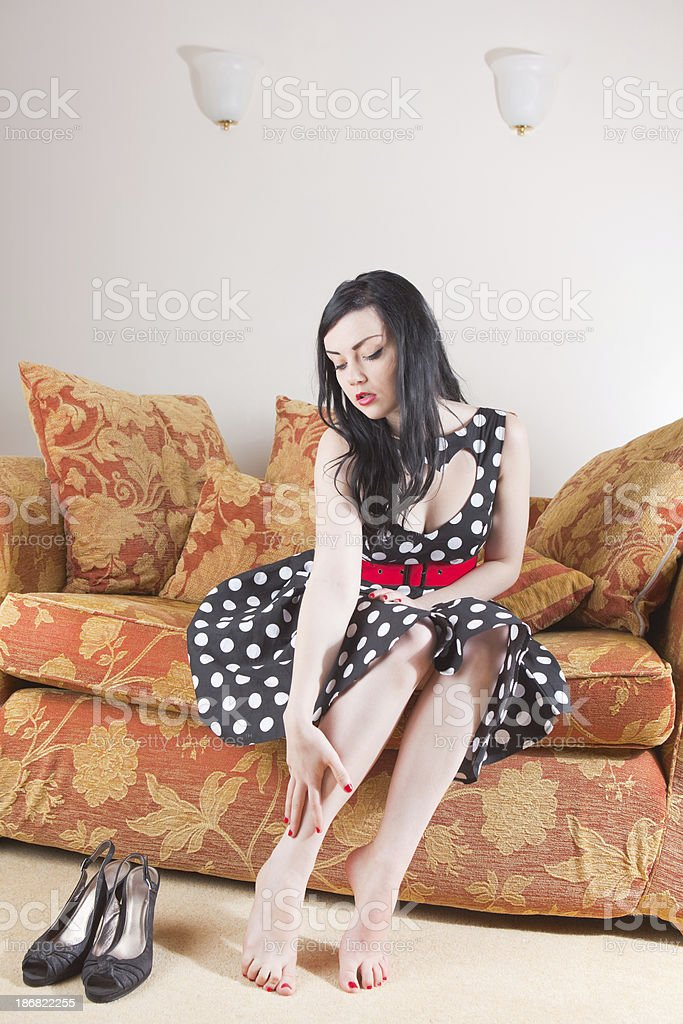 Young Lady Relaxing On A Sofa stock photo