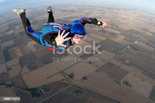 A young woman smiles and looks relaxed in freefall.