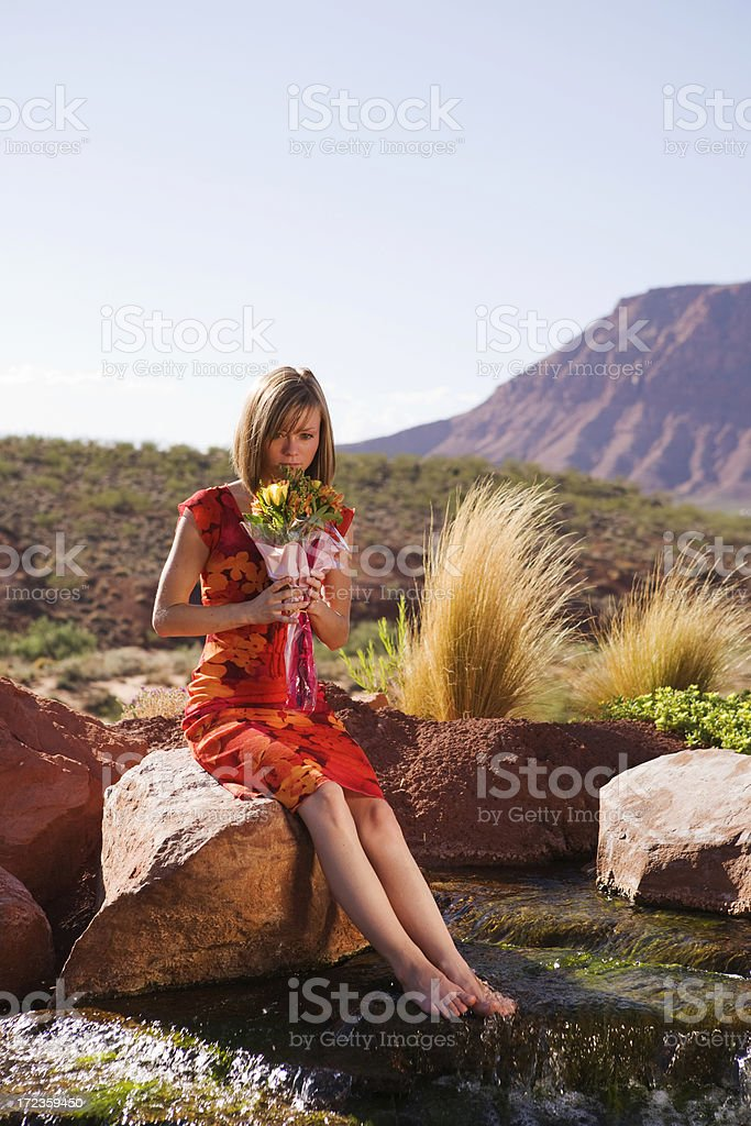 Young Lady smelling the Flowers royalty-free stock photo