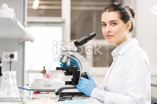 istock Young lady studying bacteria in laboratory 1147277006