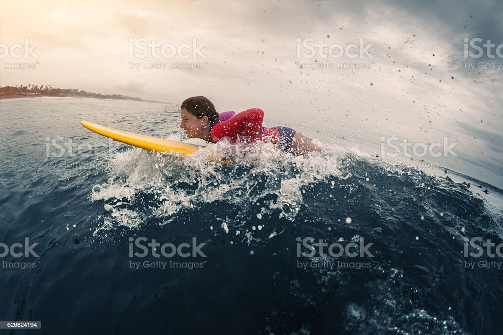 Young lady surfer stock photo