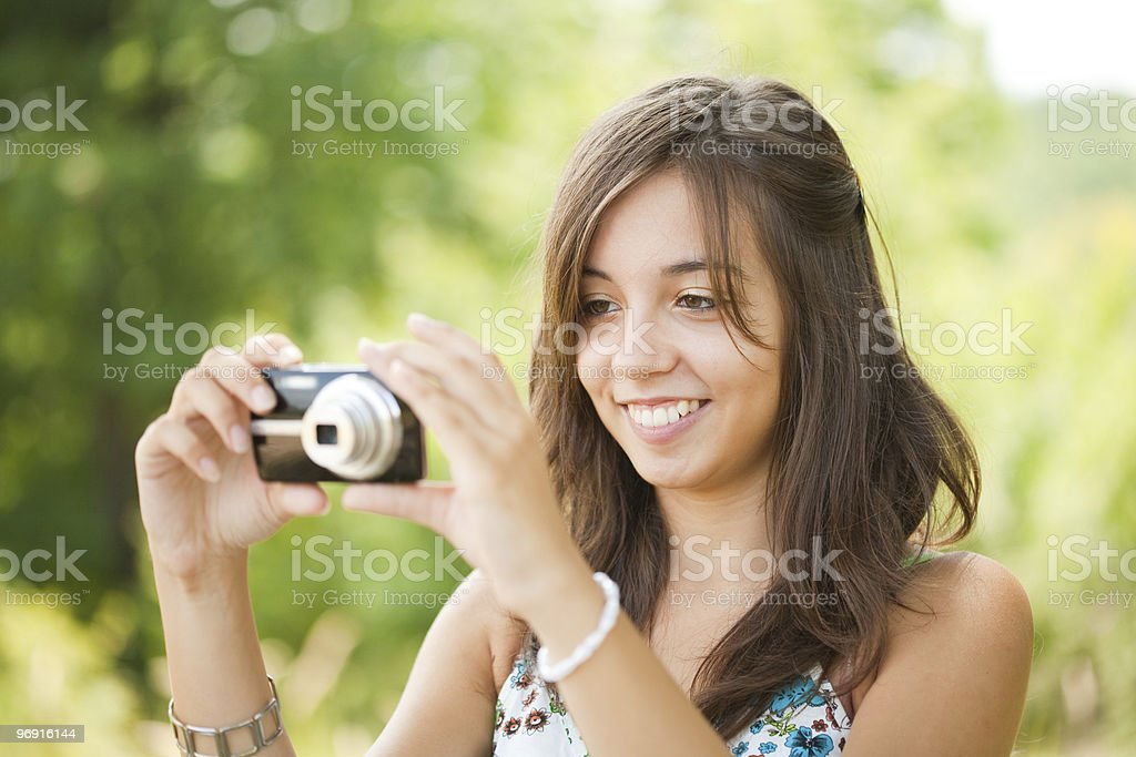 Young lady taking photos outdoors royalty-free stock photo