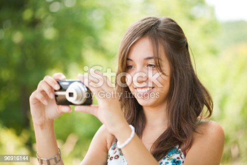Young Lady Taking Photos Outdoors Stock Photo & More Pictures of Adult