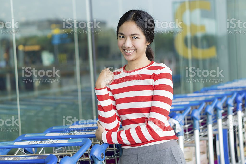 Young lady traveller in airport royalty-free stock photo