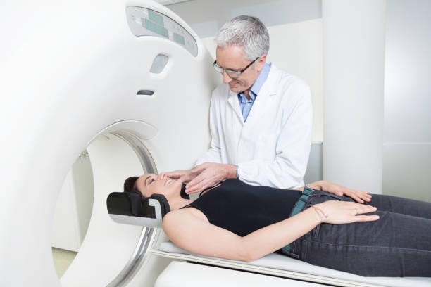 young lady with the doctor in the room of computed tomography at hospital. stock photo