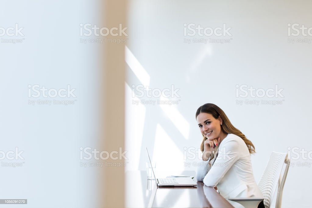 Young latin business executive working on laptop stock photo