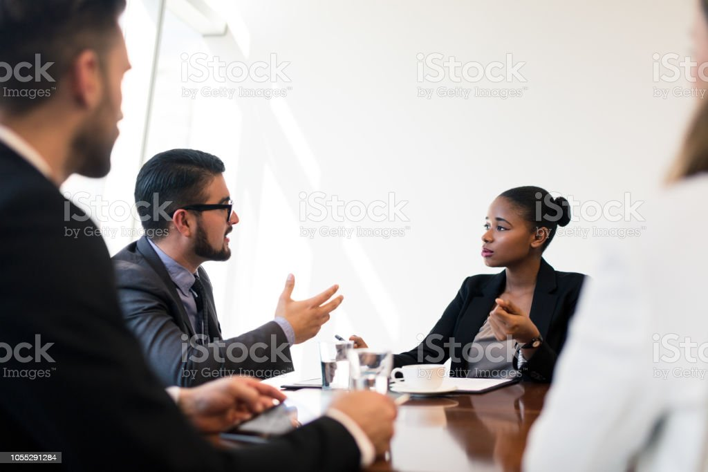 Young latin business executives in meeting stock photo