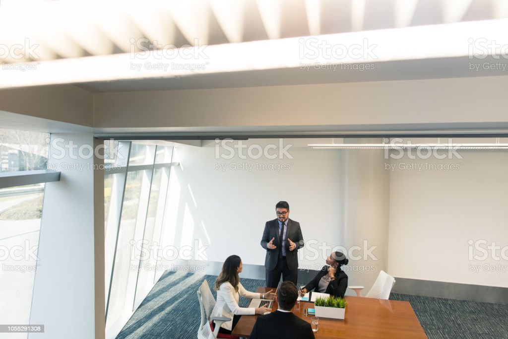 Young latin business man talking in meeting stock photo