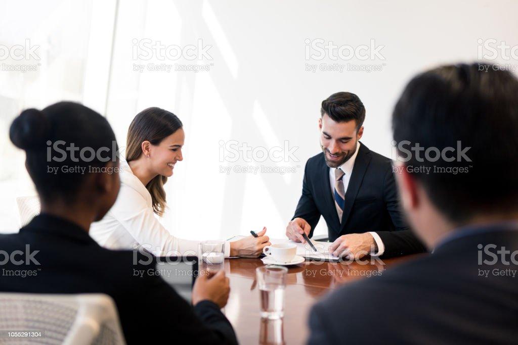 Young latin business men having a meeting stock photo