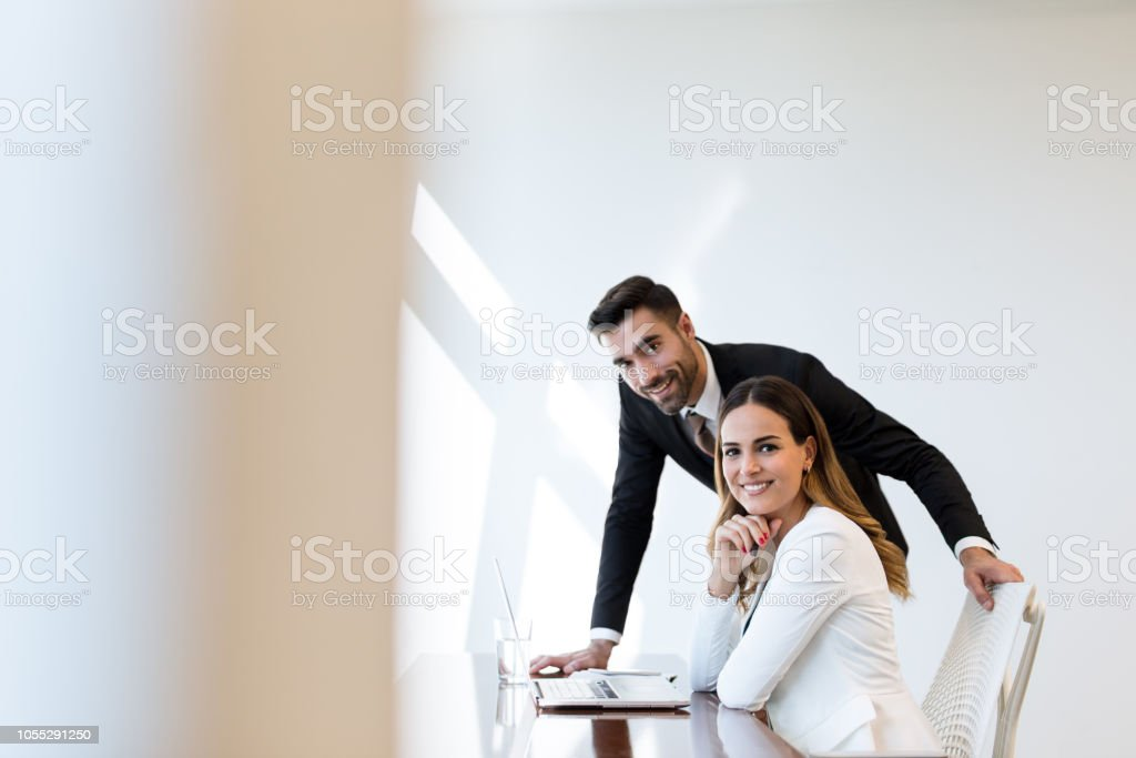 Young latin business partners workin on computer stock photo