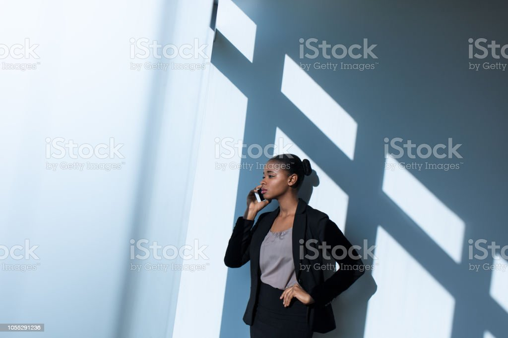 Young latin business woman talking on her phone stock photo