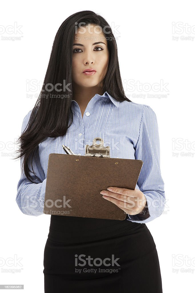 Young Latin Businesswoman with Clipboard and Pen royalty-free stock photo