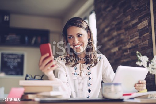 istock Young, latin businesswoman working at home 471484866