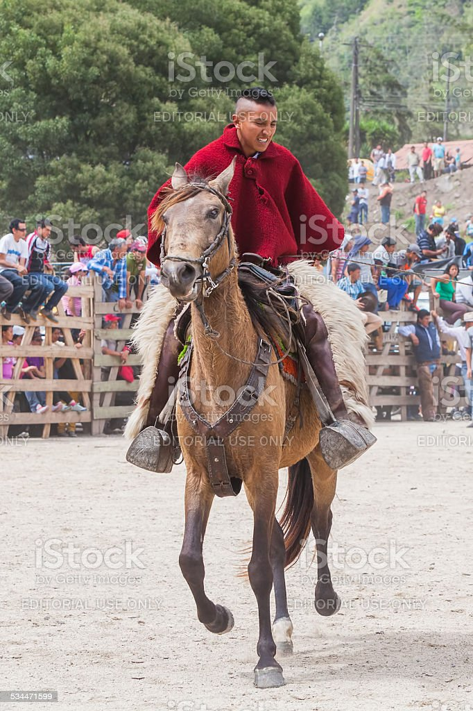 Young Latin Cowboy Learning To Ride A Horse stock photo