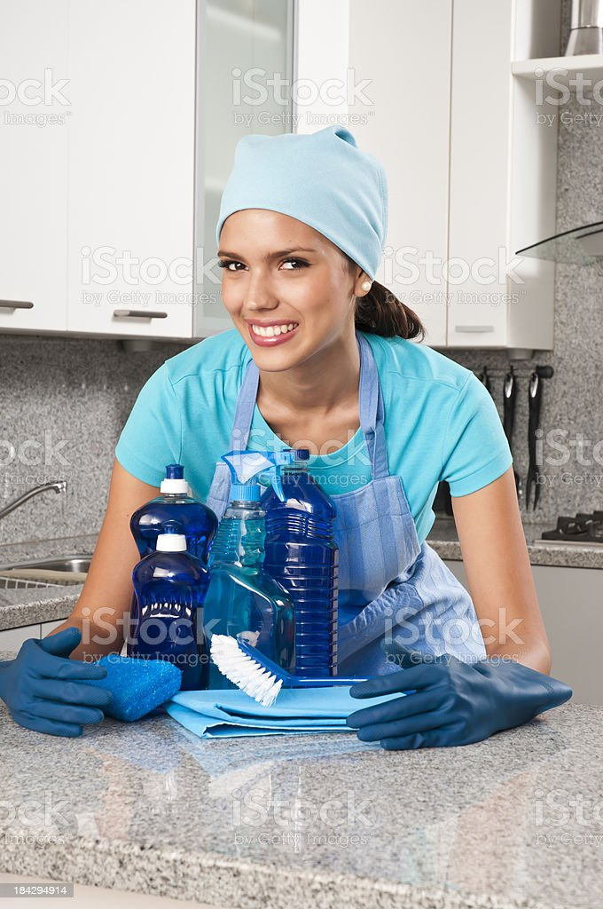 Young Latin Maid in Kitchen royalty-free stock photo