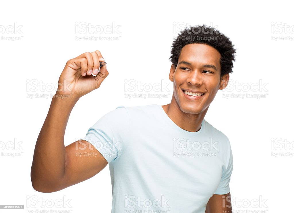 Young latin man writing on an imaginary whiteboard royalty-free stock photo