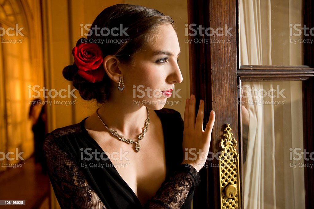 Young Latin woman Looking out Window royalty-free stock photo