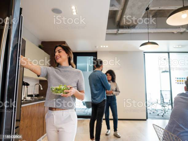 Young latin woman standing in lunch room and holding salad picture id1185430904?b=1&k=6&m=1185430904&s=612x612&h=fuofezichwcp8hoff1jkulguseocekylngdnf0jel2s=