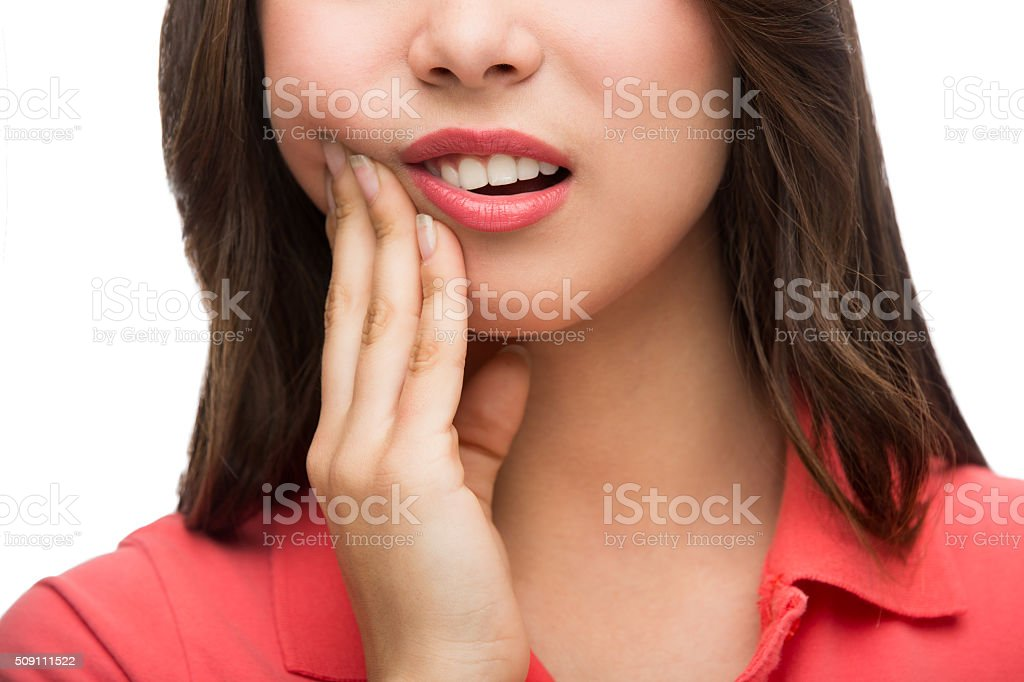 Young latin woman with hand on cheeck stock photo
