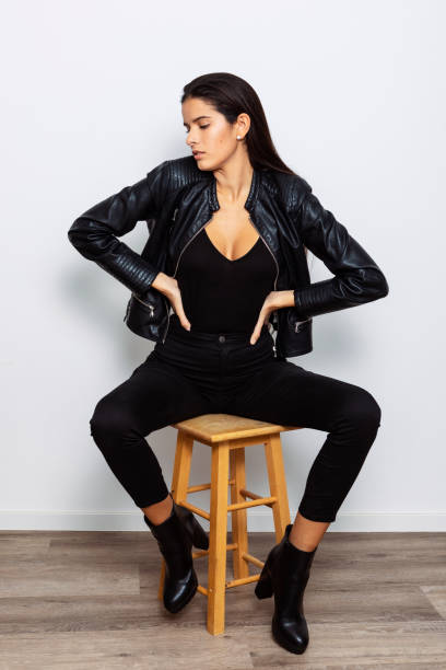 young Latina in her 20s posing in a studio stock photo