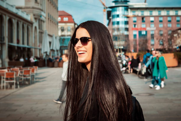 young Latina in her 20s posing in the city stock photo