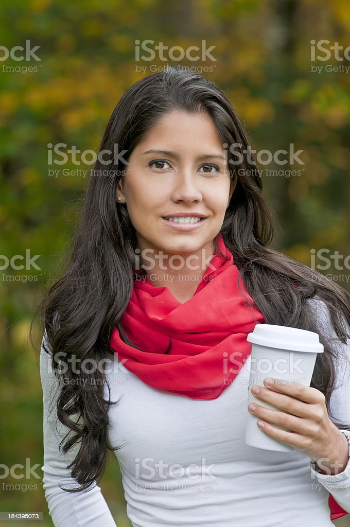 Young latina woman strolling with a cup of coffee/tea (V) royalty-free stock photo