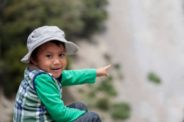 Young latino boy in awe after spotting elusive wildlife in Southern California mountains. stock photo