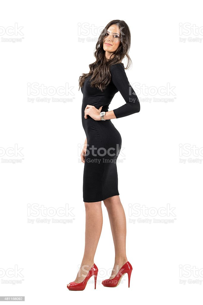 Young Latino business woman in short black dress posing stock photo