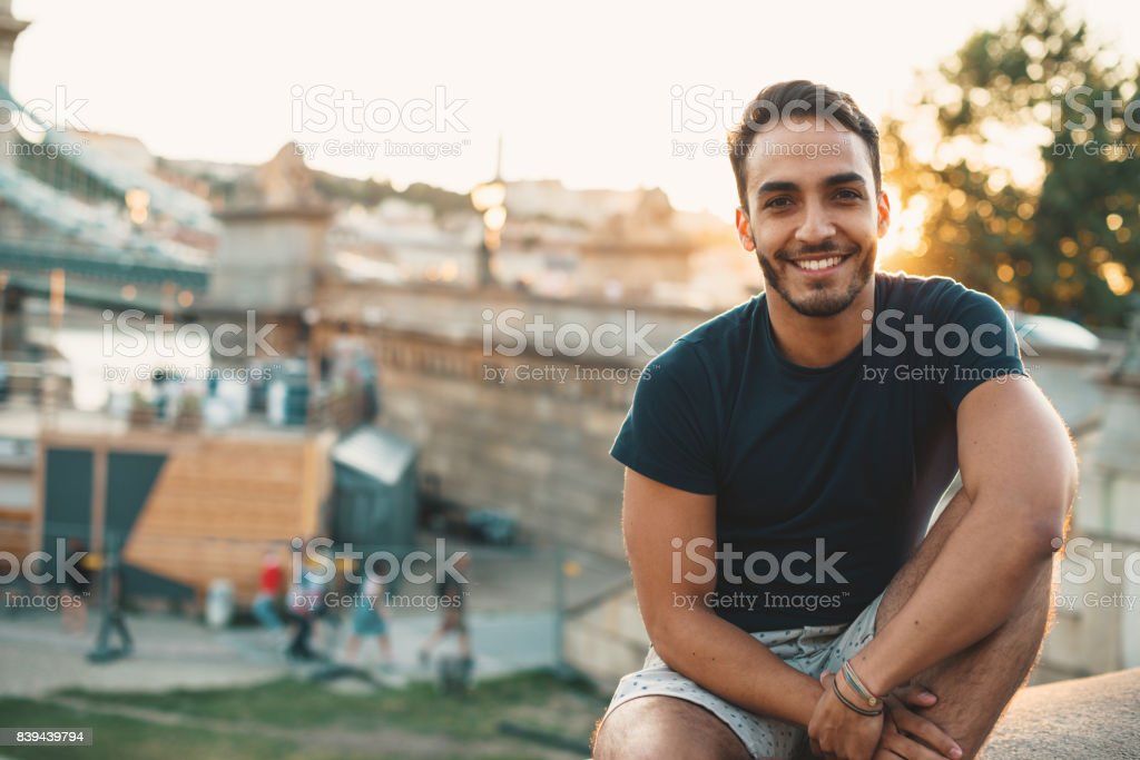 Young Latino man traveling around Europe stock photo