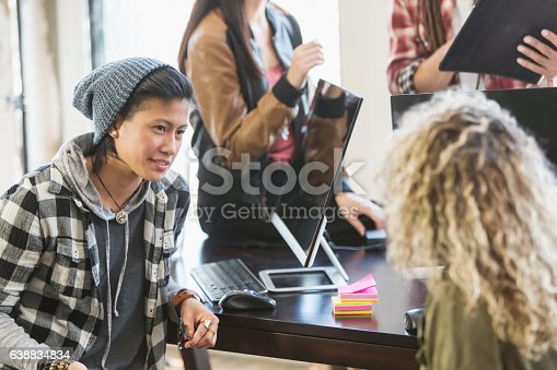 918746260istockphoto Young Latino woman in meeting for startup business 638834834