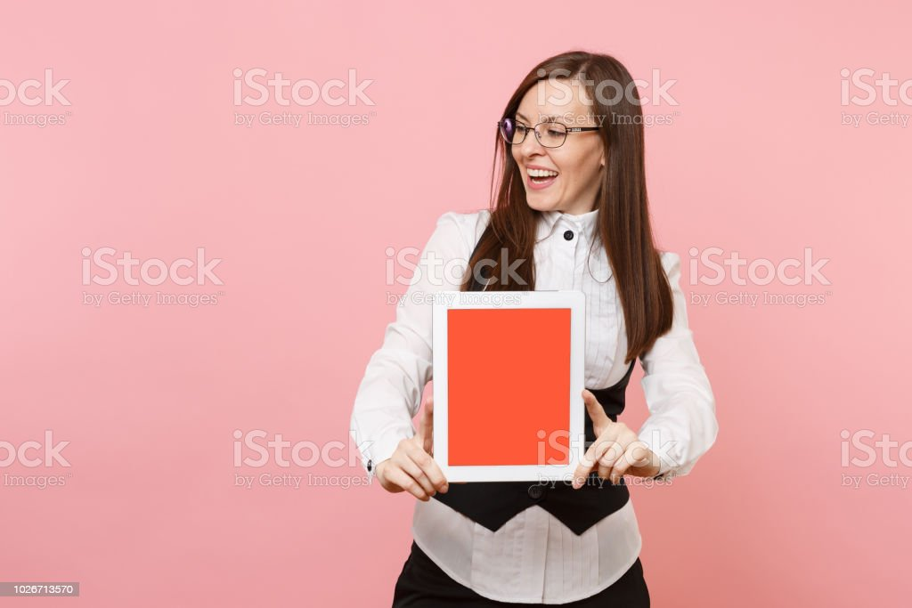 Young laughing business woman in glasses hold tablet pc computer with...