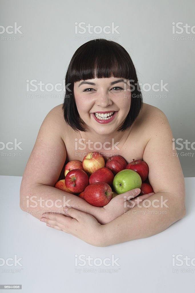 young laughing woman with apples royalty-free stock photo