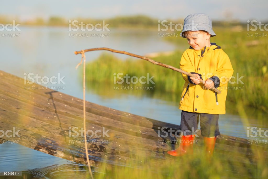 0584fdf873d1e Young Little Boy Fishing From Wooden Dock Stock Photo - Download ...