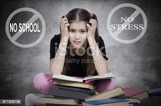 istock young little girl, stressed tired fatigued upset, sitting on pile of books, i 671326736