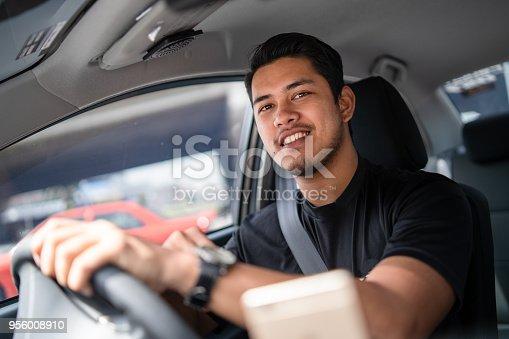 istock Young Local taxi driver in Kuala Lumpur, Malaysia. 956008910
